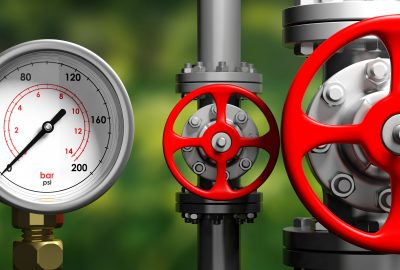 Industrial high pressure gas manometer, pipelines and valves on blur green nature background, 3d illustration